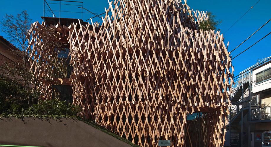 Kengo Kuma gently works with wood