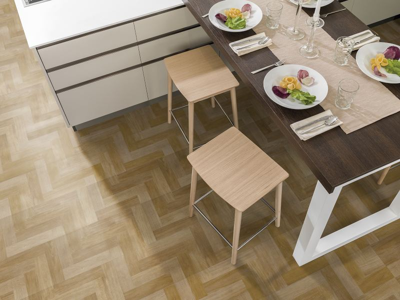 ¿Is it possible to Install laminate flooring on top of parquet floors?